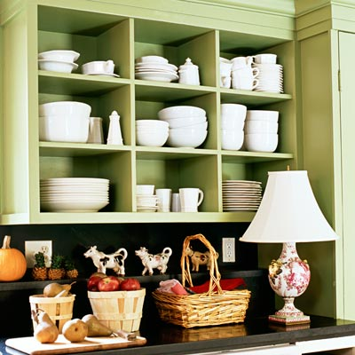 kitchen with green painted open shelving
