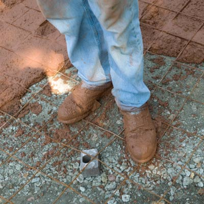 man with dirty work boots on construction site