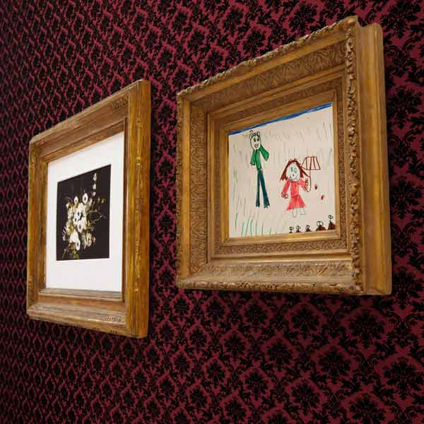 framed artwork hanging on wall