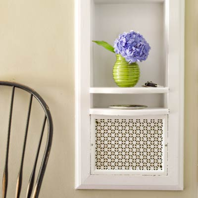 telephone nook with perforated panel in colonial revival home