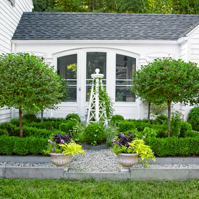 garden in front colonial revival home