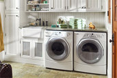 a remodeled laundry room with green towels