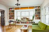 living room with white built-in bookshelves