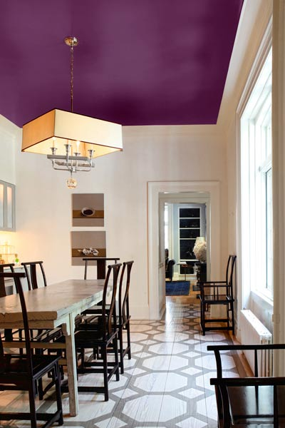 dining room with white walls and rich purple painted ceiling