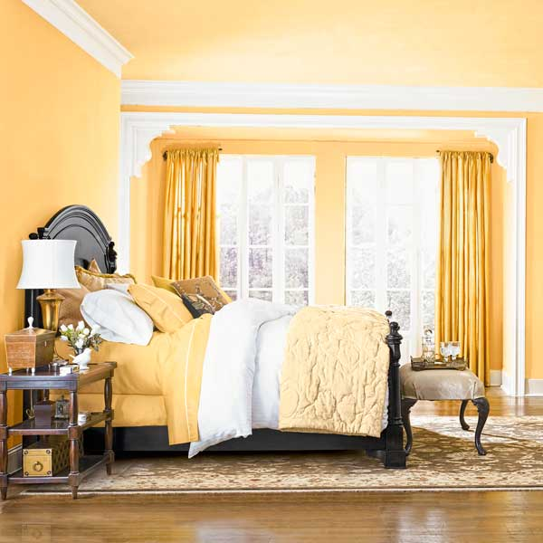 bedroom with yellow walls and ceiling