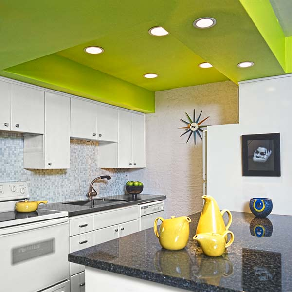 white kitchen with lime green ceiling