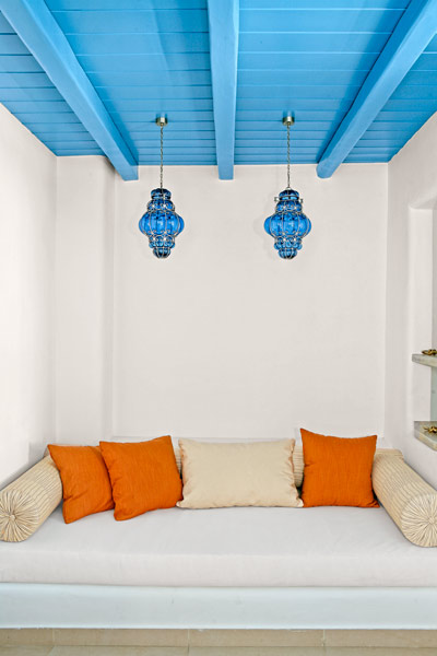 white room with exposed beam ceiling painted blue