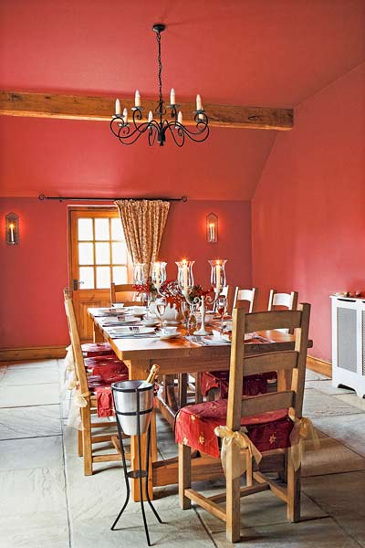 dining room with red ceiling and walls