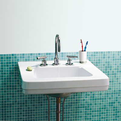 bathroom sink with blue tile