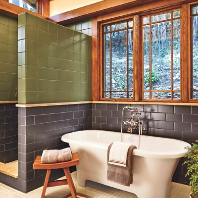 bathroom with Craftsman period finishings, tub with rolled lip and unclawed feet, clerestory windows