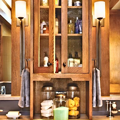 Craftsman-style sconces, bathroom cabinet with seeded-glass fronts