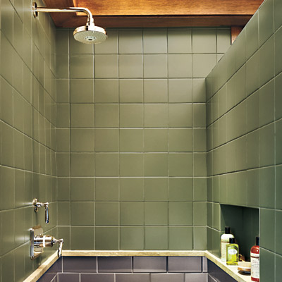 green and black matte tile shower with limestone pencil ledge