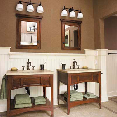 bath with matching his and hers wood vanities and mirrors