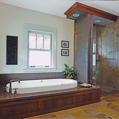 wood bath with multicolored slate tiles