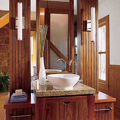 bathroom with wood vanity and mirror