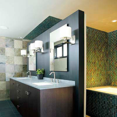 bath with wood accents and earth-toned tiles
