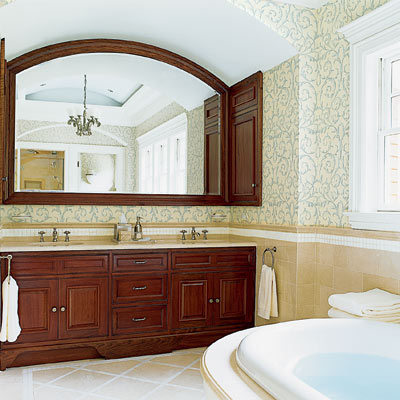 his and hers shared bathroom with wood vanity and wood framed mirror 