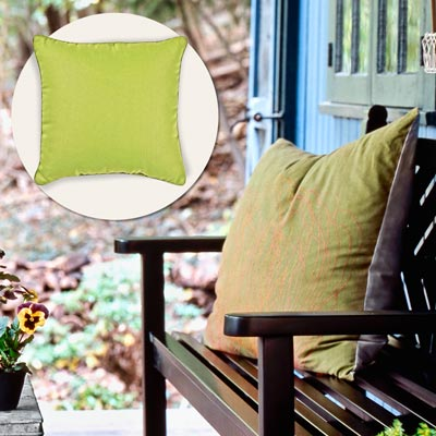 a porch with inset of a green throw pillow