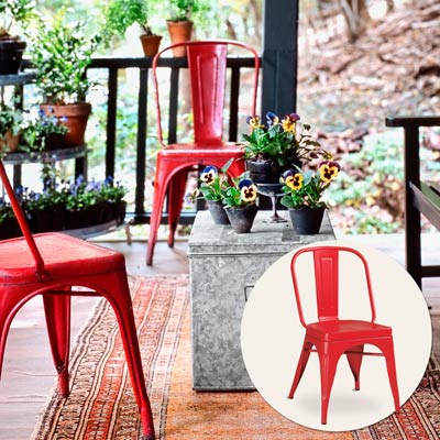 a porch with inset of a red metal chair
