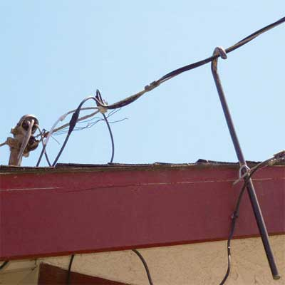 a steel crowbar hooked on the electrical main service from home inspection nightmares gallery twenty-seven