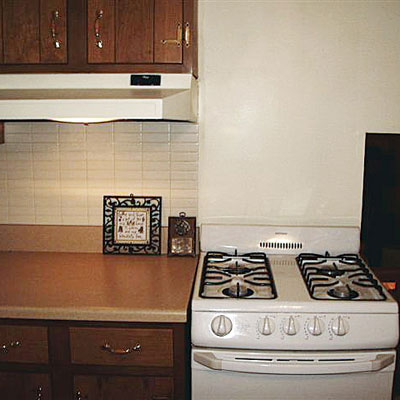 an exhaust hood over a kitchen counter but not over the stove