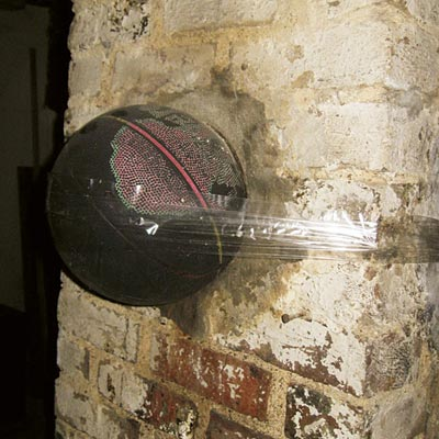 a basketball taped over a flue hole