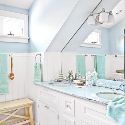 light blue and white master bath with sloped cathedral ceiling