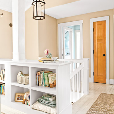stair landing with built-in bookshelf and closets in hallway