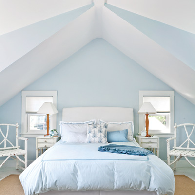 blue and white master bedroom with cathedral ceilings