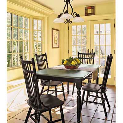 yellow dining area with table and four chairs and big windows