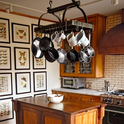 ... style kitchen remodel with island, pro-style range and vent hood