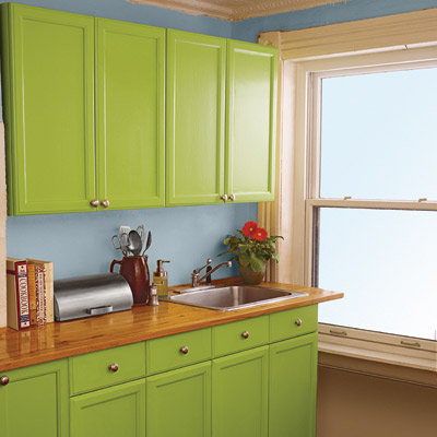 kitchen with bright green painted cabinets