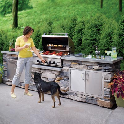 outdoor kitchen island with grill, sink and food prep area