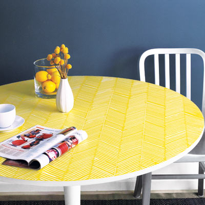white laminate table with yellow herringbone pattern on top 