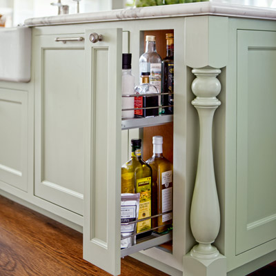after kitchen remodel narrow pullout in kitchen island to store cooking oils