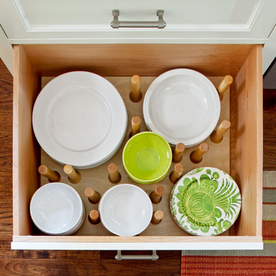after kitchen remodel dishware drawer with adjustable pegs to hold dishes