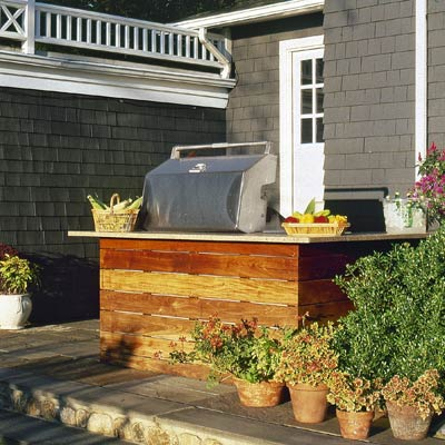 an outdoor kitchen near the back door to the patio