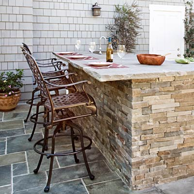 an outdoor kitchen counter with cultured-stone veneer
