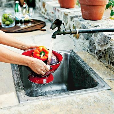 a built-in outdoor kitchen sink
