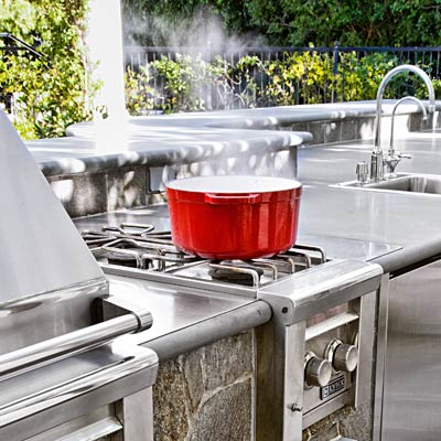 a built-in extra burner for an outdoor kitchen gas grill