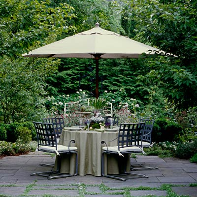 An outdoor kitchen dining area with a patio umbrella