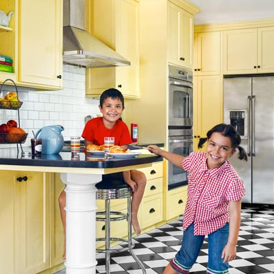 sunny yellow kitchen with classic cabinets, checkerboard floor