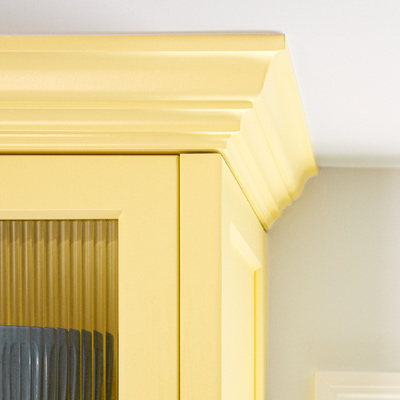 after kitchen redo yellow Shaker-style cabinets with reeded-glass fronts and crown molding
