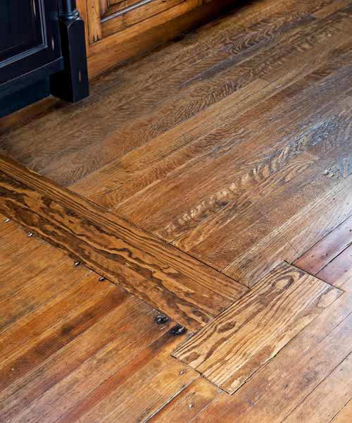 kitchen remodel after with patched-up pine wood floors