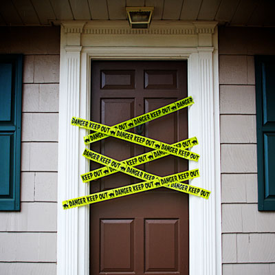 front door with yellow danger tape
