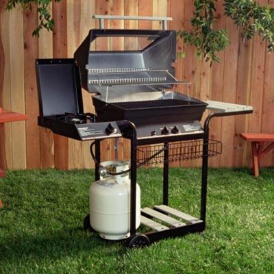 gas grill in backyard