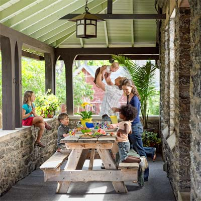 winning family on the porch of the this old house reader remodel grand prize winning house