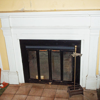 hand-carved mantel in Queen Anne house in Tillamook, Oregon for sale through Save This Old House