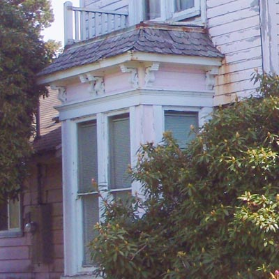 Bay window with brackets on Queen Anne house in Tillamook, Oregon for sale through Save This Old House
