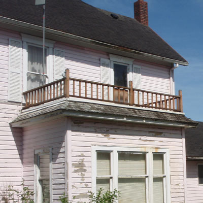 balcony on Queen Anne house in Tillamook, Oregon for sale through Save This Old House